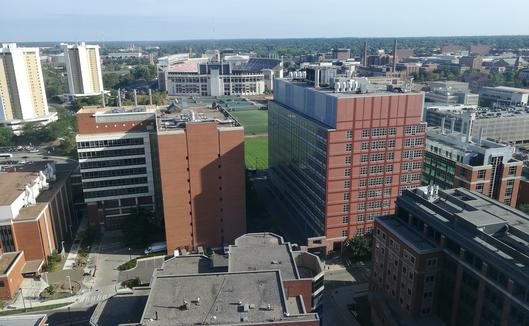 Ohio State University campus, with some of the medical buildings in the foreground and the large football stadium in the background