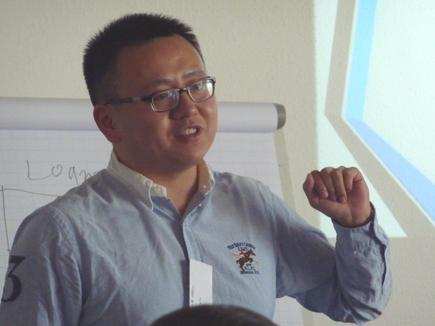 A presentation by Yu Zhang during a workshop at the International Alumni Conference 2015